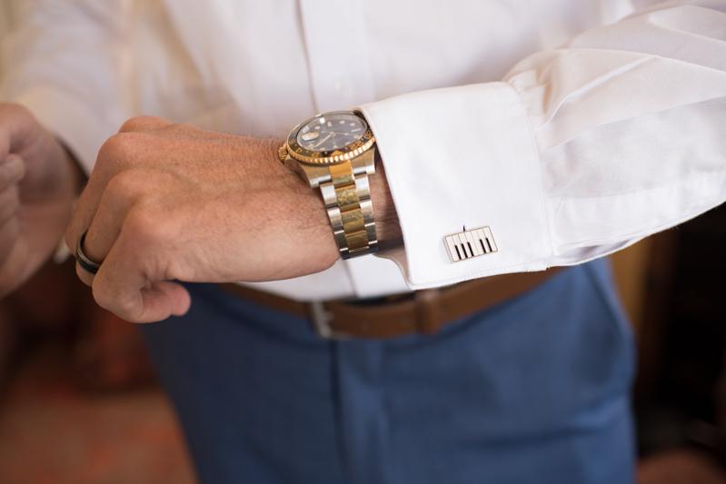 Male arm with wrist watch and piano key cufflinks