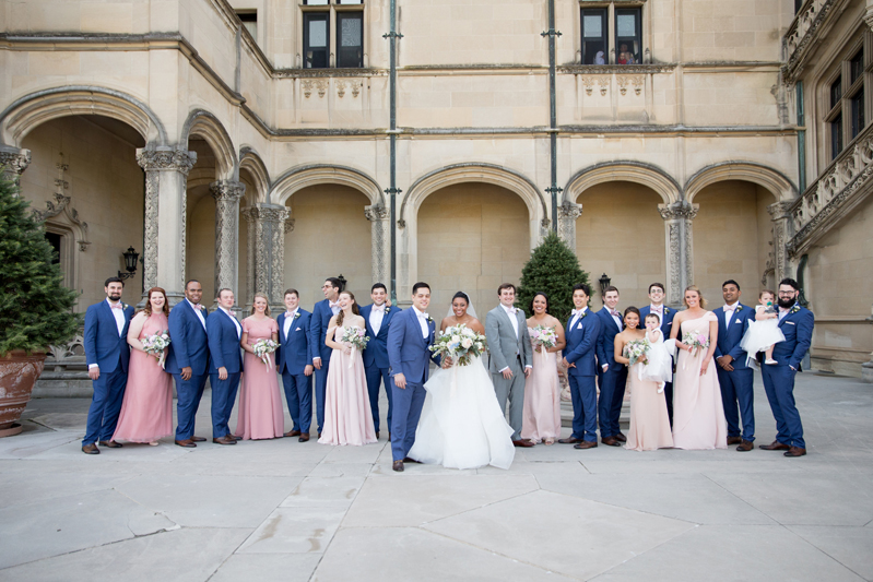 Bridal party standing outside on piazza at Diana at Biltmore wedding venue