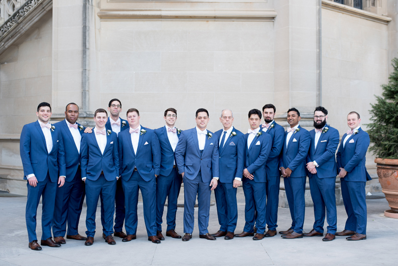 Large groomsmen party in blue suits