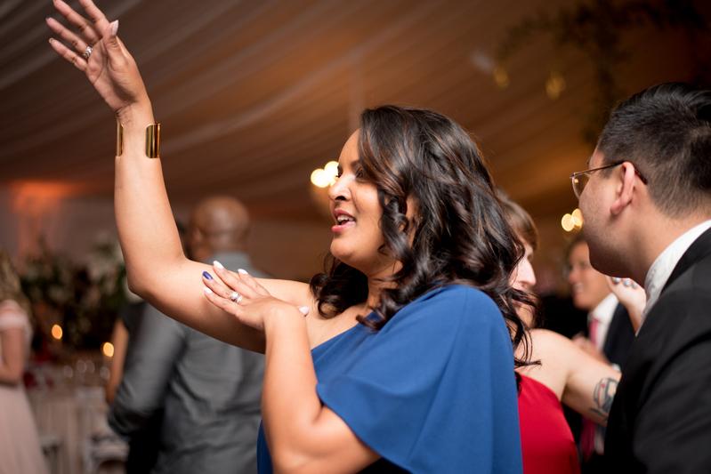 Woman dancing at wedding reception.