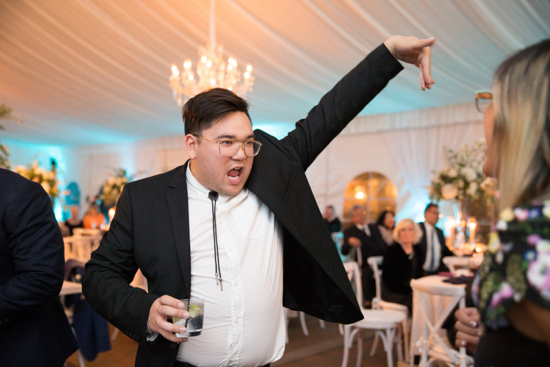 Guy in suit showing off dance moves on the dance floor