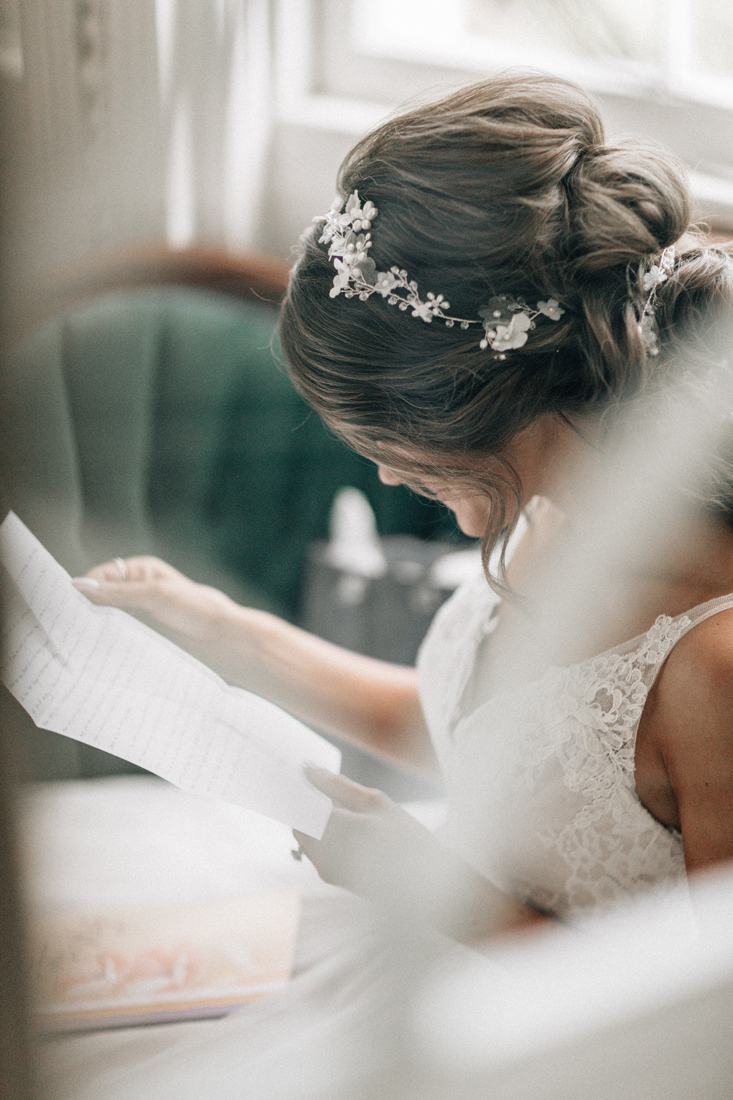 bride before wedding reading letter