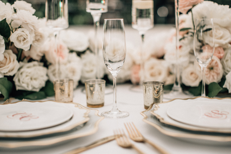 Elegant pink and gold place setting for wedding