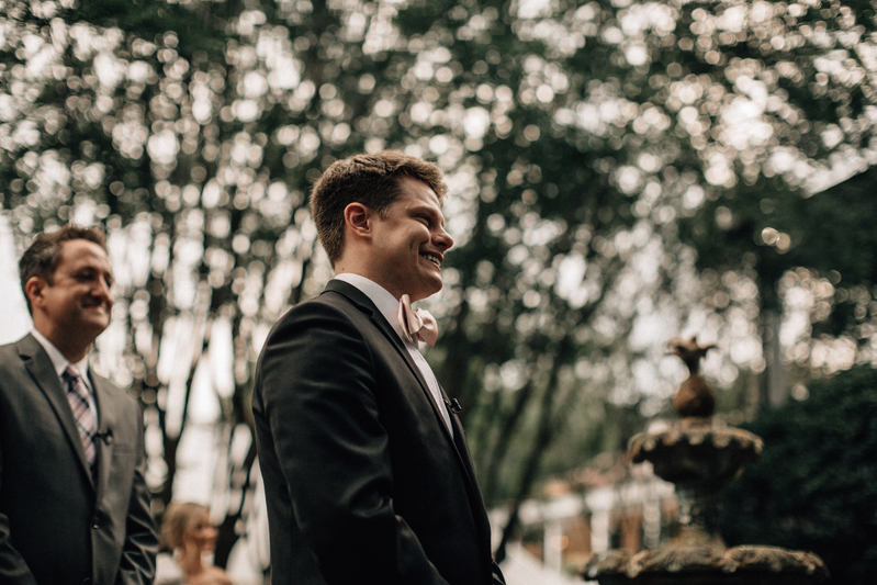 Groom waiting on bride to walk down the aisle