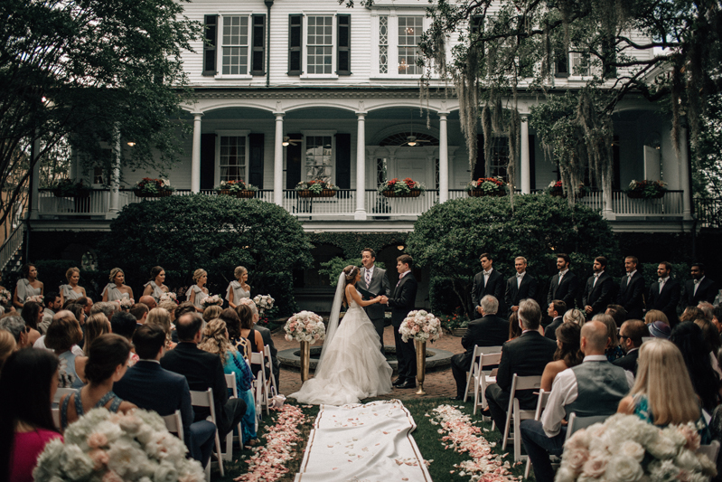Bride and groom exchanging vows at Governor Thomas Bennett House