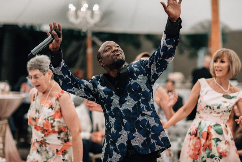 Band vocalist dancing on dance floor