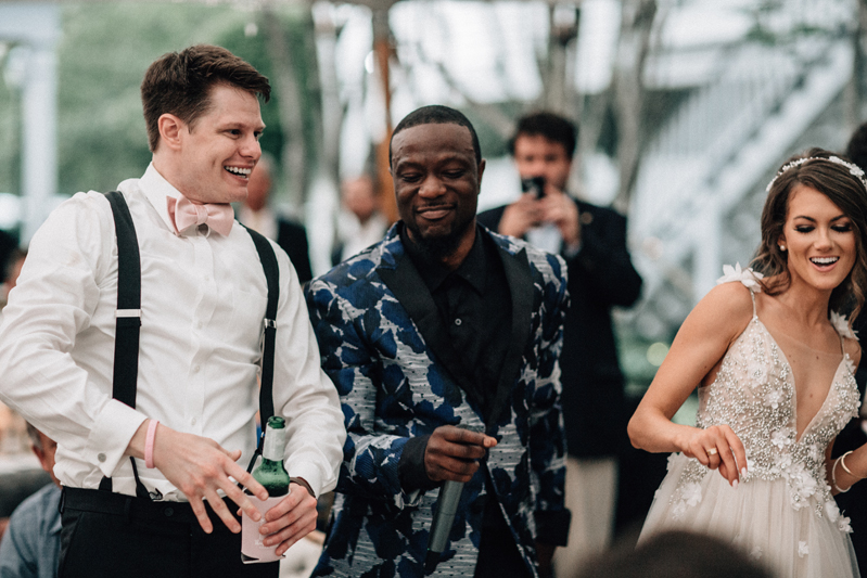 Bride, Groom and wedding musician dancing at the wedding reception