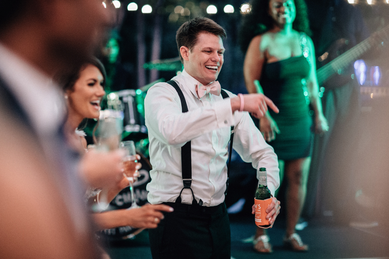 groom on dance floor with band in background