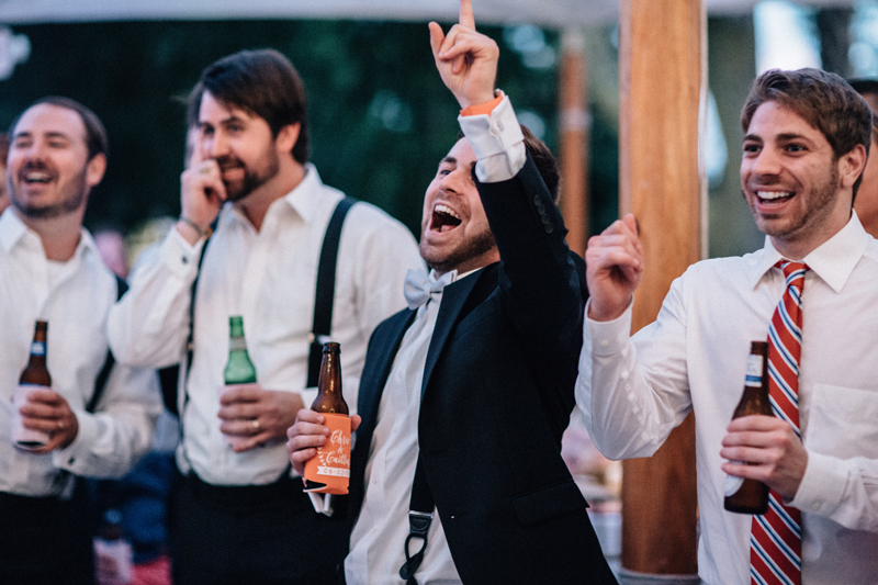 wedding guest singing on dance floor with arm raised