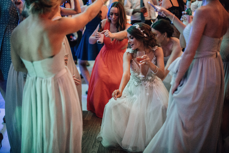 bride and friends on the dance floor