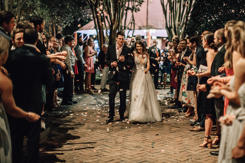 bride and groom grand exit with flower petals