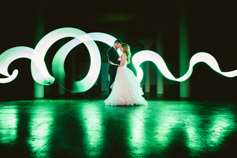 Bride and Groom dancing on green dance floor